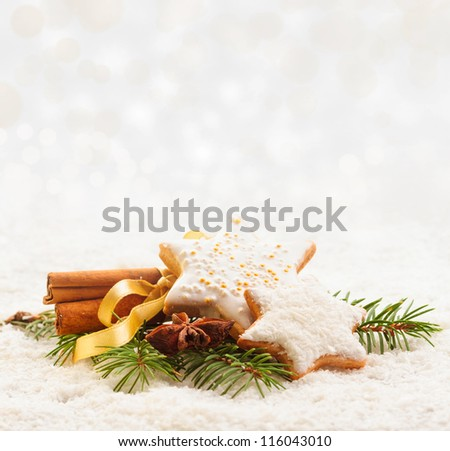 Christmas cookies with cinnamon and anise on winter background - stock photo