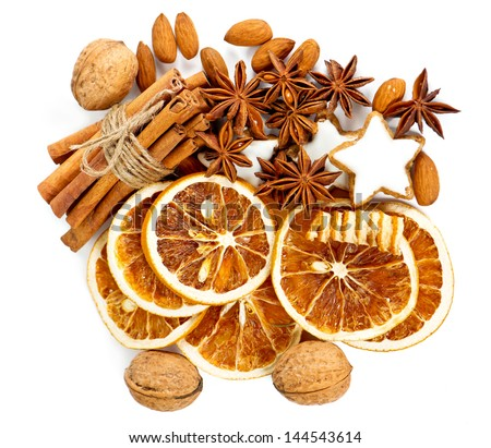 christmas cookies with cinnamon sticks, anise stars, nuts and sliced of dried orange - stock photo