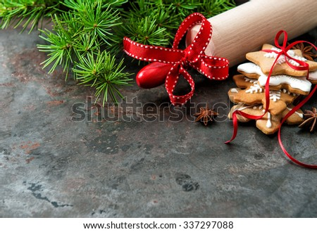 Christmas cookies with evergreen tree branches decoration. Holidays background
