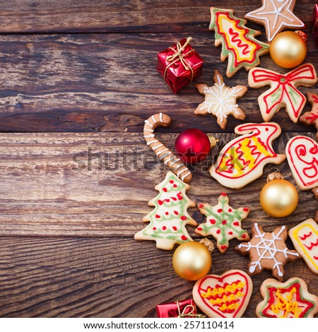 Christmas cookies with festive decoration. Gingerbread cookies hanging over wooden background. Christmas card  - stock photo