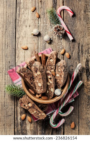 Christmas cookies with festive decoration - vintage planked wood  - stock photo