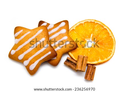 Christmas cookies with orange and cinnamon on white background - stock photo