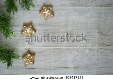 Christmas cookies with white icing at the wooden table. Selective focus