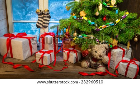 Christmas cottage full of gifts - stock photo