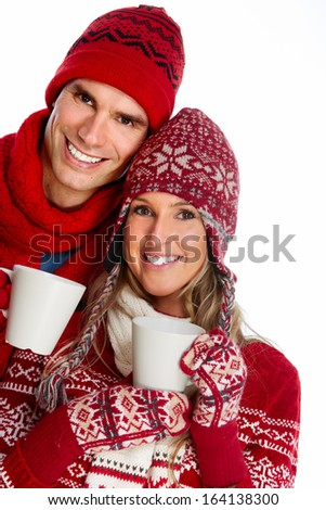 Christmas couple drinking hot tea isolated over white background.