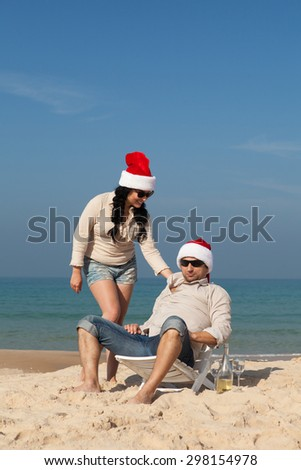 Christmas couple on a beach