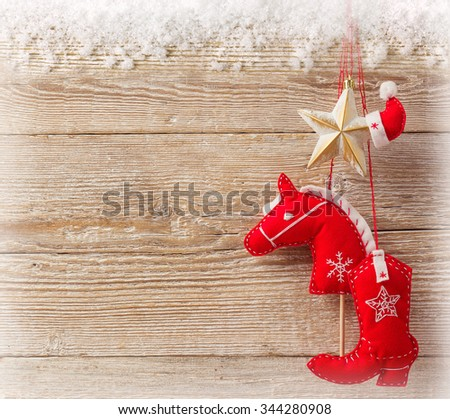 Christmas cowboy background with american western toys on wood texture - stock photo