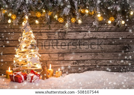 Christmas crafted decoration on wooden background, close-up.