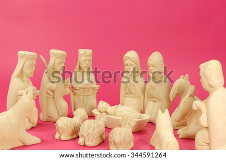 Christmas Crib Figures Curved From Wood Representing Holy Family, Vhree Wisemen, Shepherd And Animals - stock photo