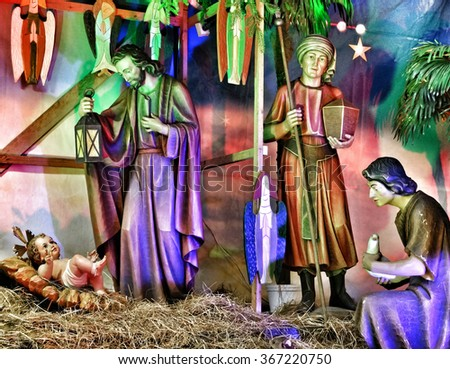 Christmas crib with child Jesus, father Josef and virgin Mary in stable. - stock photo