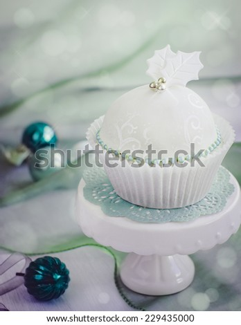 Christmas cupcake decorated with fondant. Selective focus. - stock photo