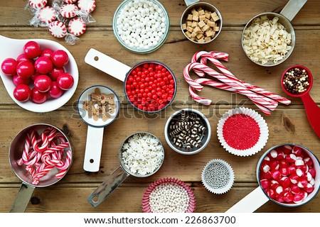 Christmas cupcake decorations and sprinkles - stock photo