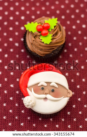 Christmas cupcake for the new year with Santa Claus - stock photo
