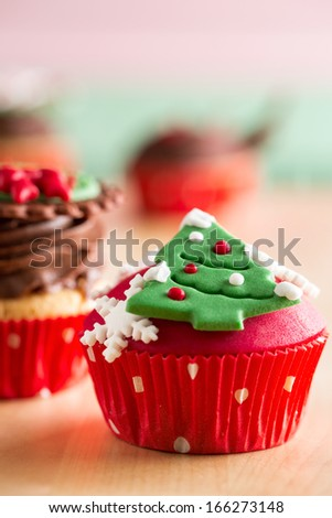 Christmas cupcake with Christmas tree as decorative symbols