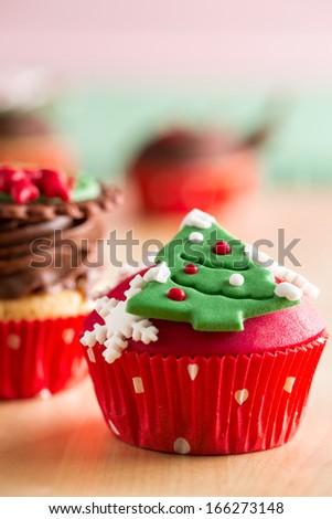 Christmas cupcake with Christmas tree as decorative symbols - stock photo
