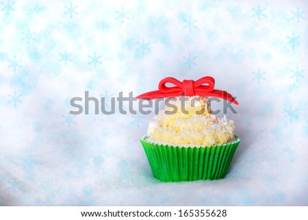 Christmas cupcake with creme cheese, cocos and white fondant - stock photo