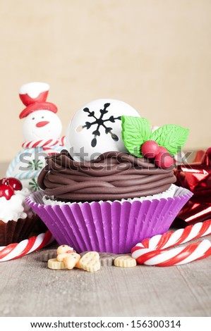 Christmas cupcakes with candy canes and cookies - stock photo