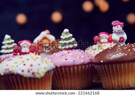 Christmas cupcakes with lights in the background