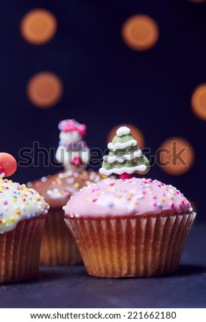 Christmas cupcakes with santa decoration and tree