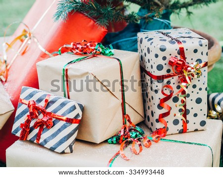 Christmas Day. Christmas gift packages with ribbons of various colors under the Christmas tree - stock photo