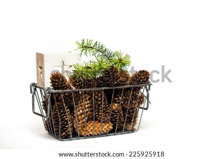 Christmas decor. cones in basket  on a white background  - stock photo