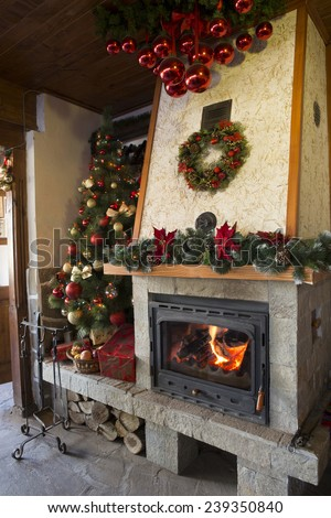 Christmas decorated burning fireplace in a restaurant - stock photo
