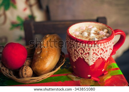 christmas decorated cup with hot chocolate and marshmallow - stock photo