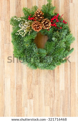 christmas decorated evergreen  wreath  on  wooden  background