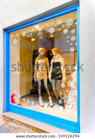 Christmas decorated vitrine with 2 dolls in Nafplio town in Greece - stock photo