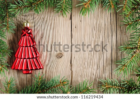 Christmas decoration and christmas tree branches on wooden background - stock photo
