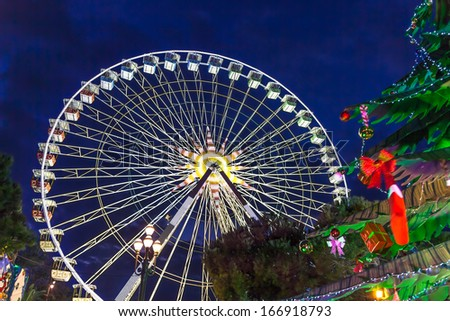 Christmas decoration and ferries wheel in Nice, France