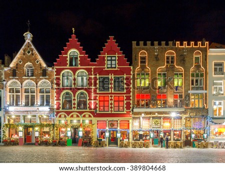 Christmas decoration and lighting Old Market Square in the historic center of Bruges, Belgium. - stock photo