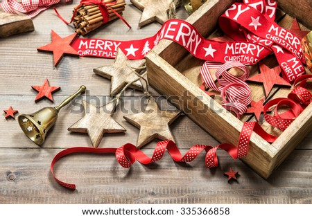 Christmas decoration and ornaments on rustic wooden background. Retro style dark toned picture