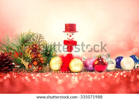 Christmas decoration  and the snowman on sweet red pink glitter lighting  background - stock photo