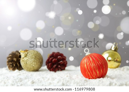 Christmas decoration ball on snow against lights background