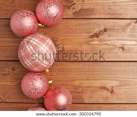 Christmas decoration balls over the wooden background as a festive copyspace composition - stock photo