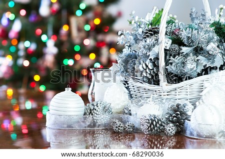 Christmas decoration basket in silver, white with tree background - stock photo