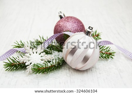 christmas decoration baubles and a branch of pine tree - stock photo