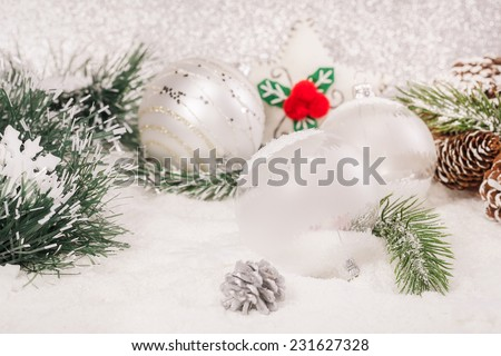Christmas decoration. Beautiful  Christmas balls decoration on shiny silver background.  A macro photograph with very shallow depth of field