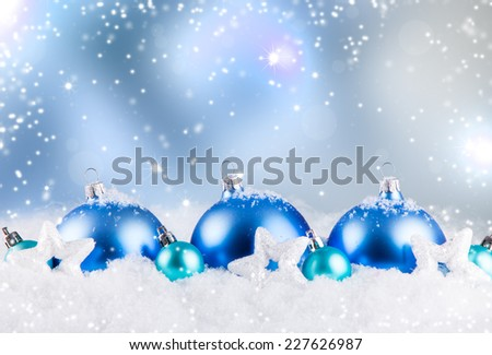 christmas decoration, Blue balls on abstract light background, snow and snowlake