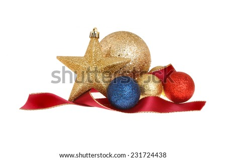 Christmas decoration, blue,gold,and red baubles with a gold star and red ribbon isolated against white - stock photo