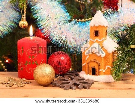 Christmas decoration - candle, house, snowflakes and balls - stock photo