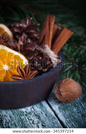Christmas decoration card with evergreen fir tree, cones, cinnamon on rustic wooden background. Selective focus, shallow dof - stock photo