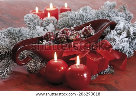 Christmas decoration, Christmas baubles and lit candles - stock photo