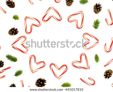 Christmas decoration: Christmas candy canes, pine cones and of fir branchs on white background with space for text. Flat lay - stock photo
