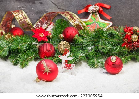 Christmas Decoration. Christmas composition with snow, red and gold Christmas decoration. Macro selective focus.  - stock photo