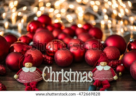 Christmas decoration. Close up Christmas text and red Christmas balls