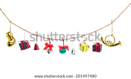 Christmas decoration collection hang on rope, isolated on white background - stock photo