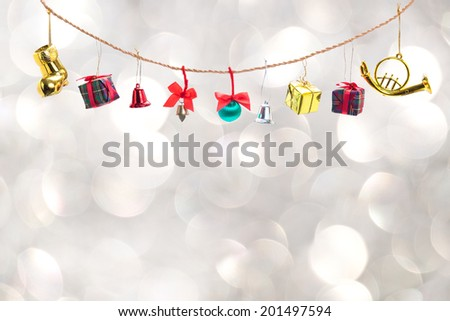 Christmas decoration collection hang on rope, on white bokeh background - stock photo