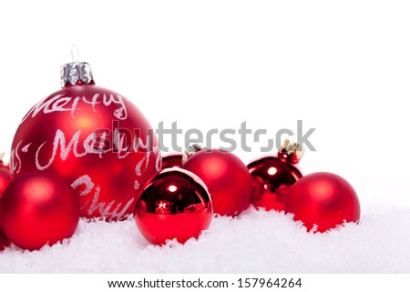 christmas decoration festive red bauble in snow isolated copy space - stock photo